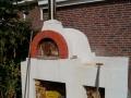 tuinontwerp met houtgestookte  pizza-oven
