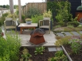 vlonderterras aan het water - tuinontwerp villatuin