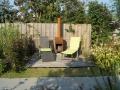 tuinontwerp Linschoten vlonderterras met tuinkachel