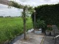 Pergola-op-vlonder-tuinontwerp-tuin-aan-het-weiland