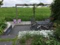 Tuinontwerp-voor-tuin-aan-het-water-met-uitzicht-op-weiland