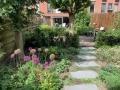 Tuinontwerp-met-veranda-tuinkamer-tuinstudio-staptegels