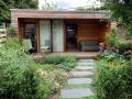 Tuinontwerp-moderne-tuin-tuinstudio-tuinkamer-veranda-sedumdak-groen-dak