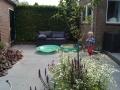 kindvriendelijke en onderhoudsarme tuin met zandbak