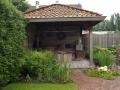 tuinontwerp met overkapping buitenkamer overdekt terras