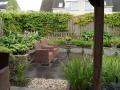 tuinontwerp romantische tuin met ronde border