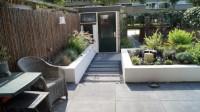 tuinontwerp moderne strakke tuin Utrecht witte muurtjes