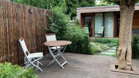 Tuinontwerp met tuinkamer en veranda - tuinarchitect Utrecht Woerden Montfoort